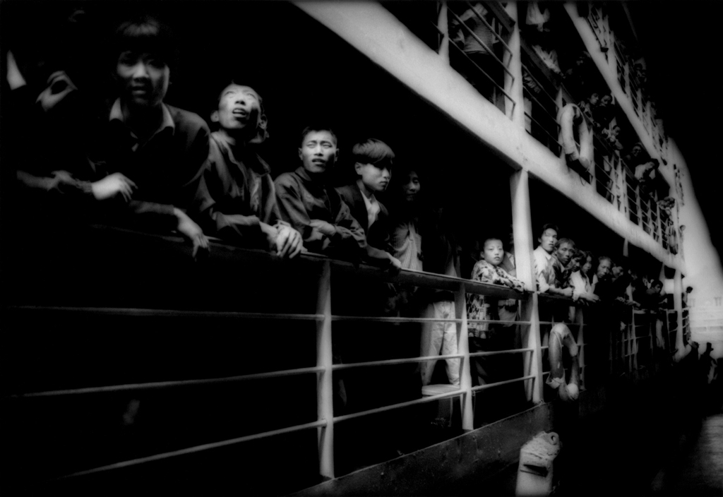Peasants crowding the rails of a river steamer. Three Gorges, Yangtze River, China. 1997