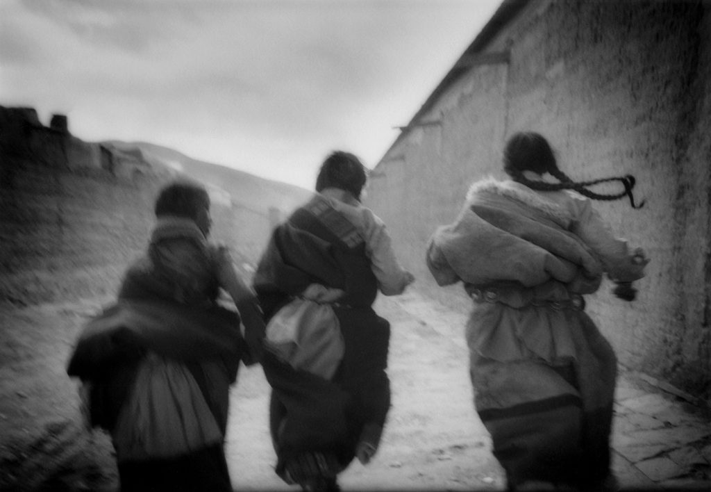 Tibetan Girls Running, Labrang, Amdo, Tibet 1996.