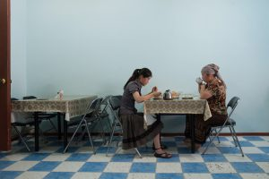 Local residents having a mean at a cafe. Mailuu-Suu, Kyrgyzstan 2012